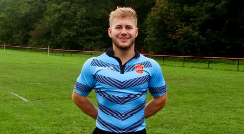Person in a rugby uniform in a field